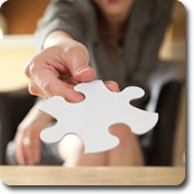woman handing over a blank puzzle piece
